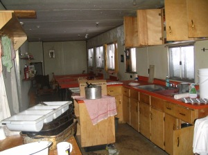 This is the kitchen at the abandoned mine. There was still food in pans and on plates. In the rooms the sheets and blankets were rumpled and clothes were in closets.